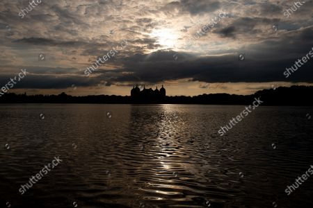 Moritzburg Castle is seen behind a lake in Moritzburg, Germany, during the sunset hours on 14 May 2020. The famous Saxony castle is named after Duke Moritz, who had it built as a hunting lodge near his residence in Dresden in 1542. Moritzburg Castle hosts apart from many other contemporary treasures one of the most outstanding collections of hunting trophies in Europe.