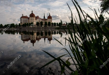 Moritzburg Castle reflected in a lake in Moritzburg, Germany, 14 May 2020. The famous Saxony castle is named after Duke Moritz, who had it built as a hunting lodge near his residence in Dresden in 1542. Moritzburg Castle hosts apart from many other contemporary treasures one of the most outstanding collections of hunting trophies in Europe.