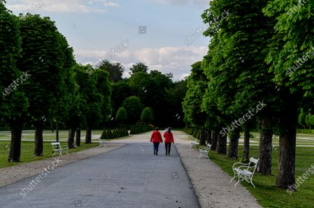 People walk in the Moritzburg Castle Park, in Moritzburg, Germany, 14 May 2020. The famous Saxony castle is named after Duke Moritz, who had it built as a hunting lodge near his residence in Dresden in 1542. Moritzburg Castle hosts apart from many other contemporary treasures one of the most outstanding collections of hunting trophies in Europe.
