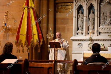 Father Don Richardson holds a holy mass at St Mary's Cathedral in Sydney, Australia, 15 May 2020. Catholic churches across New South Wales (NSW) have opened their doors for private prayer, confession and small-scale masses amid easing of COVID-19 restrictions.