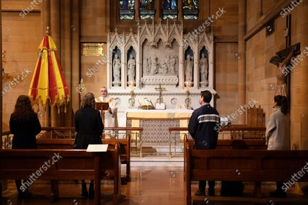 Father Don Richardson (3-L) holds a holy mass at St Mary's Cathedral in Sydney, Australia, 15 May 2020. Catholic churches across New South Wales (NSW) have opened their doors for private prayer, confession and small-scale masses amid easing of COVID-19 restrictions.