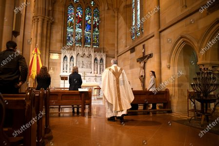 Father Don Richardson (C) holds a holy mass at St Mary's Cathedral in Sydney, Australia, 15 May 2020. Catholic churches across New South Wales (NSW) have opened their doors for private prayer, confession and small-scale masses amid easing of COVID-19 restrictions.