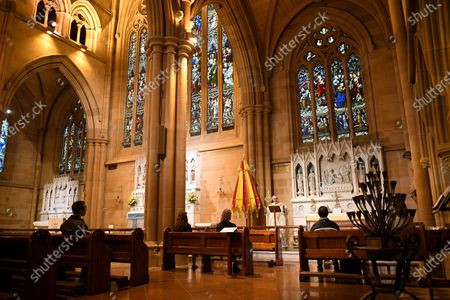Father Don Richardson (C, back) holds a holy mass at St Mary's Cathedral in Sydney, Australia, 15 May 2020. Catholic churches across New South Wales (NSW) have opened their doors for private prayer, confession and small-scale masses amid easing of COVID-19 restrictions.