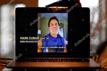 """University of Pittsburgh graduate Dallas Mavericks owner Mark Cuban congratulates members of the Class of 2020 during a virtual commencement on a computer screen in Pittsburgh. As the coronavirus leaves colleges holding """"virtual graduation"""" events online, many schools are recruiting famous figures to deliver speeches over their laptops instead of the lectern"""