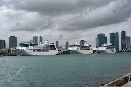 "'Sirena' ship of 'Oceana Cruises, from left, Norwegian Cruise Lines - Empress of the Seas'. Downtown Miami in the background. As per 'USA Today', Norwegian Cruise Line expects its entire fleet will be able to resume full operations in five to six months. The cruise brand shared the news in its earnings report for the first quarter of 2020, which ended on March 31. Frank Del Rio, CEO of Norwegian Cruise Line Holdings Ltd., said that Norwegian is planning a phased relaunch. He expects it will take up to six months to resume fleetwide operations across Norwegian Cruise Line Holdings' 28 ships, which are spread across its three brands: flagship Norwegian Cruise Line, Oceania Cruises and Regent Seven Seas Cruises. ""Nothing will be more critical to resuming sustained and profitable long term operations than making cruising the safest option in (the) travel and leisure space and providing cruisers with peace of mind,"" Del Rio said on Thursday's earnings call. Norwegian cruises suspended through end of June. All Norwegian Cruise Line cruises were suspended after the Centers for Disease Control and Prevention imposed a 100-day no-sail order following outbreaks on ships belonging to multiple cruise lines. Both passengers and crew were infected and some vessels were turned away from ports in several nations. Port of Miami in Miami, Fla."