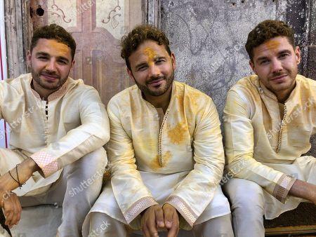 Stock Photo of Adam Thomas, Ryan Thomas and Scott Thomas during the Tumeric Festival.