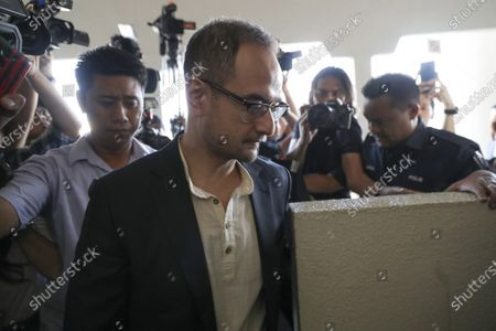 "Riza Aziz, stepson of Malaysian former Prime Minister Najib Razak, walks into a court room at Kuala Lumpur High Court in Kuala Lumpur, Malaysia. Malaysian prosecutors have dropped money laundering charges against ""The Wolf of Wall Street"" producer and stepson of former premier Najib Razak, in a move slammed by Human Rights Watch as a ""triumph for impunity and corruption"