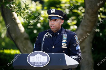New York City police officer Spencer Garrett speaks during a presidential recognition ceremony in the Rose Garden of the White House, in Washington. Garrett has returned to duty after recovering from coronavirus