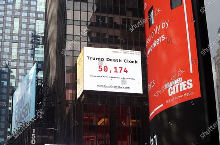 "Stock Image of An electronic sign displays the ""Trump Death Clock"" in Times Square in New York City. Created by by filmmaker Eugene Jarecki, the 56-foot billboard displays the estimated portion of U.S. COVID-19 deaths caused by President Trump's delayed response to the pandemic."