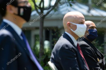 (L-R) US Secretary of the Treasury Steven T. Mnuchin, Stephen Hahn, commissioner of food and drugs at the U.S. Food and Drug Administration (FDA), and Vice Admiral Jerome Adams, US Surgeon General, listen as US President Donald J. Trump delivers remarks regarding Coronavirus vaccine developments in the Rose Garden of the White House in Washington, DC, USA on 15 May 2020.