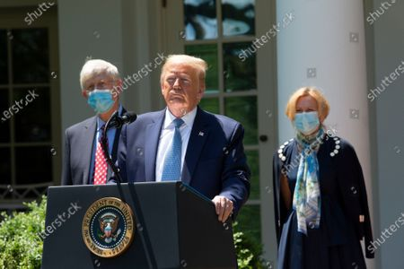 US President Donald J. Trump delivers remarks regarding Coronavirus vaccine developments in the Rose Garden of the White House in Washington, DC, USA on 15 May 2020. National Institutes of Health Director Dr. Francis Collins (L) and White House coronavirus response coordinator, Dr. Deborah Birx (R) look on.