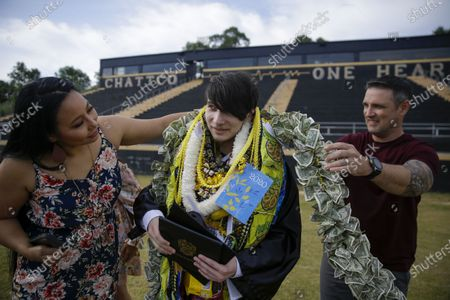 Isaac Keanu Reeves is given several leis as a Hawaiian tradition after he graduates with limited family attending. His family and friends who could not be present left laminated notes to congratulate Reeves at Chattahoochee County High School, amid the coronavirus pandemic in Cusseta, Ga