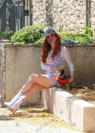 Phoebe Price is seen out with her dog during quarantine