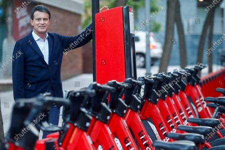 French former prime minister and Barcelona Pel Canvi party spokesman, Manuel Valls poses for a photograph next to station of bike for rent, during an interview in Barcelona, Spain, 16 May 2020.