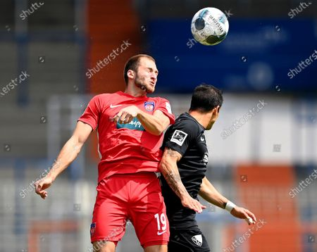 Luna Gamboa (R) of Bochum challenges Jonas Foehrenbach of Heidenheim during the German Bundesliga second division soccer match between VfL Bochum 1848 and 1. FC Heidenheim 1846 at Vonovia Ruhrstadion in Bochum, Germany, 16 May 2020. The Bundesliga and Second Bundesliga is the first professional league to resume the season after the nationwide lockdown due to the ongoing Coronavirus (COVID-19) pandemic. All matches until the end of the season will be played behind closed doors.