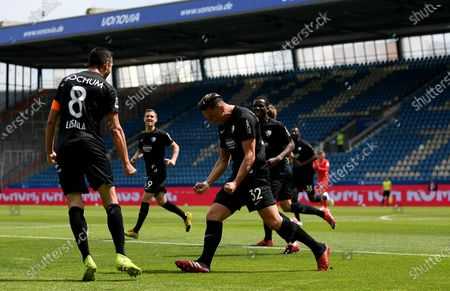 Anthony Losilla (L) of Bochum celebrates with teammates after scoring the opening goal during the German Bundesliga Second Division soccer match between VfL Bochum 1848 and 1. FC Heidenheim 1846 at Vonovia Ruhrstadion in Bochum, Germany, 16 May 2020. The Bundesliga and Second Bundesliga are the first professional leagues to resume the season after the nationwide lockdown due to the ongoing Coronavirus (COVID-19) pandemic. All matches until the end of the season will be played behind closed doors.