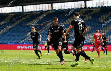 Anthony Losilla (R) of Bochum celebrates with teammates after scoring the opening goal during the German Bundesliga Second Division soccer match between VfL Bochum 1848 and 1. FC Heidenheim 1846 at Vonovia Ruhrstadion in Bochum, Germany, 16 May 2020. The Bundesliga and Second Bundesliga are the first professional leagues to resume the season after the nationwide lockdown due to the ongoing Coronavirus (COVID-19) pandemic. All matches until the end of the season will be played behind closed doors.