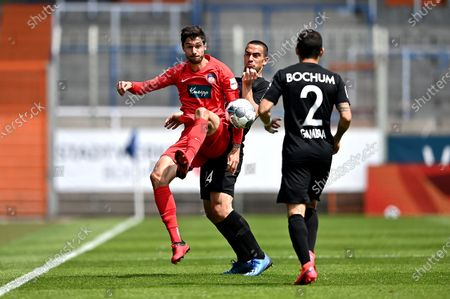Vasilios Lampropoulos (C) of Bochum challenges Tim Kleindienst (L) of Heidenheim during the German Bundesliga Second Division soccer match between VfL Bochum 1848 and 1. FC Heidenheim 1846 at Vonovia Ruhrstadion in Bochum, Germany, 16 May 2020. The Bundesliga and Second Bundesliga are the first professional leagues to resume the season after the nationwide lockdown due to the ongoing Coronavirus (COVID-19) pandemic. All matches until the end of the season will be played behind closed doors.