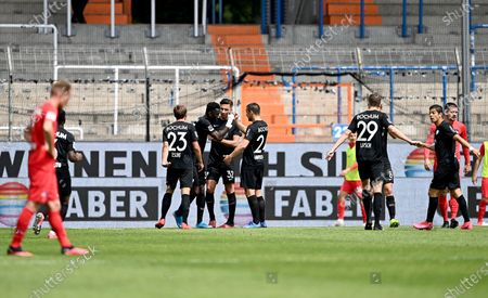 Mboussy Ganvoula (2-L) of Bochum celebrates with teammates after scoring during the German Bundesliga Second Division soccer match between VfL Bochum 1848 and 1. FC Heidenheim 1846 at Vonovia Ruhrstadion in Bochum, Germany, 16 May 2020. The Bundesliga and Second Bundesliga are the first professional leagues to resume the season after the nationwide lockdown due to the ongoing Coronavirus (COVID-19) pandemic. All matches until the end of the season will be played behind closed doors.