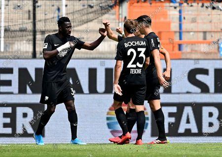 Mboussy Ganvoula (L) of Bochum celebrates with teammates after scoring during the German Bundesliga Second Division soccer match between VfL Bochum 1848 and 1. FC Heidenheim 1846 at Vonovia Ruhrstadion in Bochum, Germany, 16 May 2020. The Bundesliga and Second Bundesliga are the first professional leagues to resume the season after the nationwide lockdown due to the ongoing Coronavirus (COVID-19) pandemic. All matches until the end of the season will be played behind closed doors.
