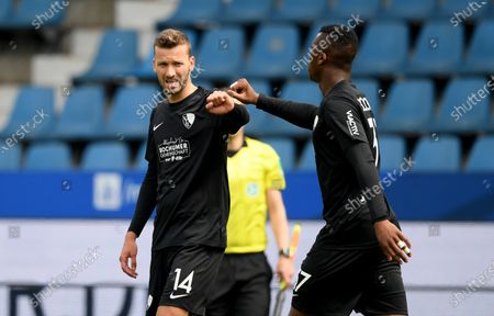Stock Photo of Tom Weilandt (L) and Armel Bella Kotchap of Bochum celebrate victory after the German Bundesliga Second Division soccer match between VfL Bochum 1848 and 1. FC Heidenheim 1846 at Vonovia Ruhrstadion in Bochum, Germany, 16 May 2020. The Bundesliga and Second Bundesliga are the first professional leagues to resume the season after the nationwide lockdown due to the ongoing Coronavirus (COVID-19) pandemic. All matches until the end of the season will be played behind closed doors.