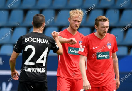 Vasilos Lampropoulos (L) of Bochum shake hands with Sebastian Griesbeck (C) of Heidenheim  after the German Bundesliga Second Division soccer match between VfL Bochum 1848 and 1. FC Heidenheim 1846 at Vonovia Ruhrstadion in Bochum, Germany, 16 May 2020. The Bundesliga and Second Bundesliga are the first professional leagues to resume the season after the nationwide lockdown due to the ongoing Coronavirus (COVID-19) pandemic. All matches until the end of the season will be played behind closed doors.