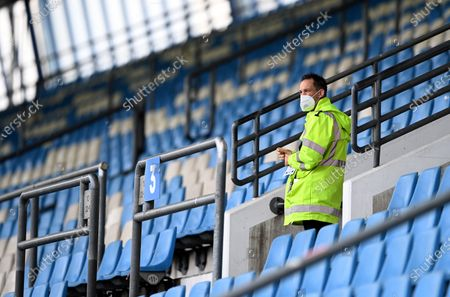A steward stands in the tribune prior to the Second Bundesliga soccer match between VfL Bochum 1848 and 1. FC Heidenheim 1846 at Vonovia Ruhrstadion in Bochum, Germany, 16 May 2020. The Bundesliga and Second Bundesliga are the first professional leagues to resume the season after the nationwide lockdown due to the ongoing Coronavirus (COVID-19) pandemic. All matches until the end of the season will be played behind closed doors.