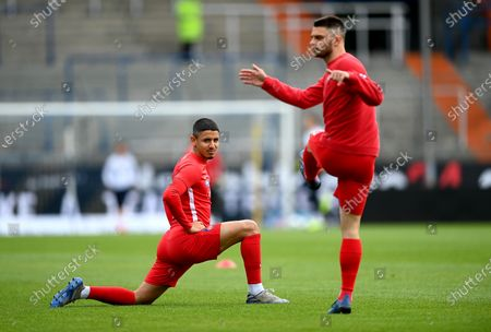 Kevin Sessa (L) of Heidenheim warms up before the Second Bundesliga soccer match between VfL Bochum 1848 and 1. FC Heidenheim 1846 at Vonovia Ruhrstadion in Bochum, Germany, 16 May 2020. The Bundesliga and Second Bundesliga are the first professional leagues to resume the season after the nationwide lockdown due to the ongoing Coronavirus (COVID-19) pandemic. All matches until the end of the season will be played behind closed doors.