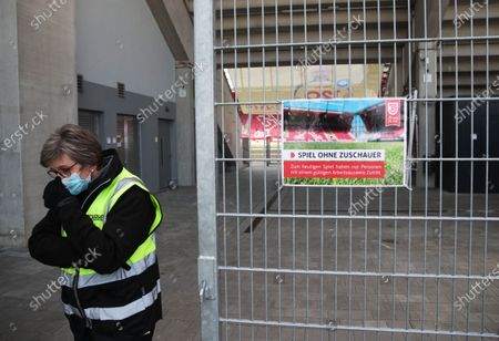 A security guard wears a face mask inside the stadium before the Second Bundesliga match between SSV Jahn Regensburg and Holstein Kiel at Continental Arena in Regensburg, Germany, 16 May 2020. The Bundesliga and Second Bundesliga are the first professional leagues to resume the season after the nationwide lockdown due to the ongoing Coronavirus (COVID-19) pandemic. All matches until the end of the season will be played behind closed doors.