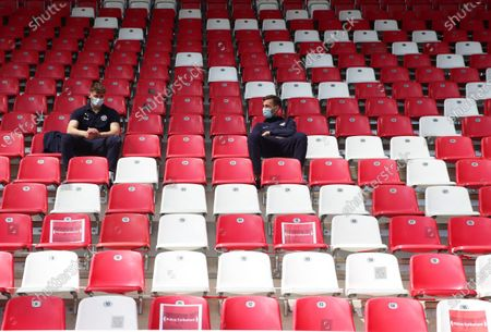 Players sit in the stands before the Second Bundesliga match between SSV Jahn Regensburg and Holstein Kiel at Continental Arena in Regensburg, Germany, 16 May 2020. The Bundesliga and Second Bundesliga are the first professional leagues to resume the season after the nationwide lockdown due to the ongoing Coronavirus (COVID-19) pandemic. All matches until the end of the season will be played behind closed doors.