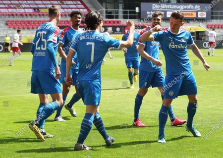 Lee Jae-Song (C) of Holstein Kiel celebrates with teammate Fabian Reese (R) of Holstein Kiel after scoring during the German Bundesliga Second Division soccer match between SSV Jahn Regensburg and Holstein Kiel at Continental Arena in Regensburg, Germany, 16 May 2020. The Bundesliga and Second Bundesliga are the first professional leagues to resume the season after the nationwide lockdown due to the ongoing Coronavirus (COVID-19) pandemic. All matches until the end of the season will be played behind closed doors.