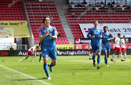 Lee Jae-Song (L) of Holstein Kiel celebrates after scoring during the German Bundesliga Second Division soccer match between SSV Jahn Regensburg and Holstein Kiel at Continental Arena in Regensburg, Germany, 16 May 2020. The Bundesliga and Second Bundesliga are the first professional leagues to resume the season after the nationwide lockdown due to the ongoing Coronavirus (COVID-19) pandemic. All matches until the end of the season will be played behind closed doors.