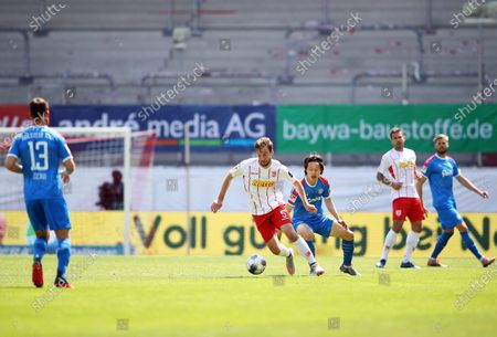 Florian Heister (C-L) of Jahn Regensburg in action during the German Bundesliga Second Division soccer match between SSV Jahn Regensburg and Holstein Kiel at Continental Arena in Regensburg, Germany, 16 May 2020. The Bundesliga and Second Bundesliga are the first professional leagues to resume the season after the nationwide lockdown due to the ongoing Coronavirus (COVID-19) pandemic. All matches until the end of the season will be played behind closed doors.