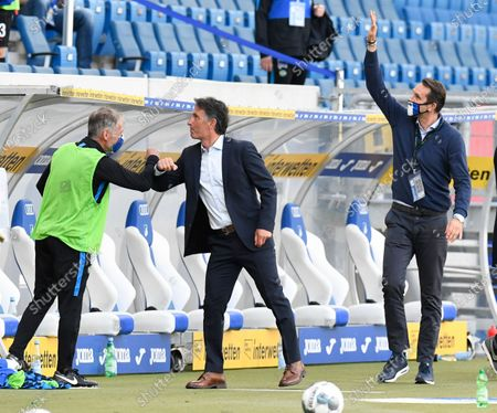 Hertha's head coach Bruno Labbadia (C) and manager Michael Preetz (R) react after the German Bundesliga soccer match between TSG 1899 Hoffenheim and Hertha Berlin in Sinsheim, Germany, 16 May 2020. The German Bundesliga and Bundesliga Second Division are the first professional leagues to resume the season after the nationwide lockdown due to the ongoing Coronavirus (COVID-19) pandemic. All matches until the end of the season will be played behind closed doors.
