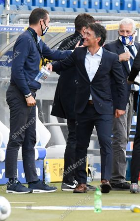 Hertha's German head coach Bruno Labbadia (R) is congratulated by manager Michael Preetz after his team won 3-0 in the German first division Bundesliga football match TSG Hoffenheim v Hertha BSC Berlin in Sinsheim, Germany, 16 May 2020. The German Bundesliga and Bundesliga Second Division are the first professional leagues to resume the season after the nationwide lockdown due to the ongoing Coronavirus (COVID-19) pandemic. All matches until the end of the season will be played behind closed doors.