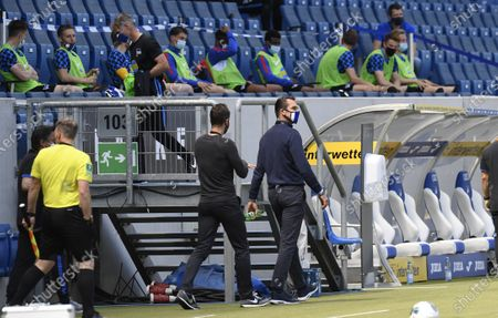 Hertha's manager Michael Preetz wears a face mask as he enters the stadium while Hertha's substitution players sit on the stands to keep the distance prior to the German Bundesliga soccer match between TSG 1899 Hoffenheim and Hertha Berlin in Sinsheim, Germany, 16 May 2020. The German Bundesliga and Bundesliga Second Division are the first professional leagues to resume the season after the nationwide lockdown due to the ongoing Coronavirus (COVID-19) pandemic. All matches until the end of the season will be played behind closed doors.