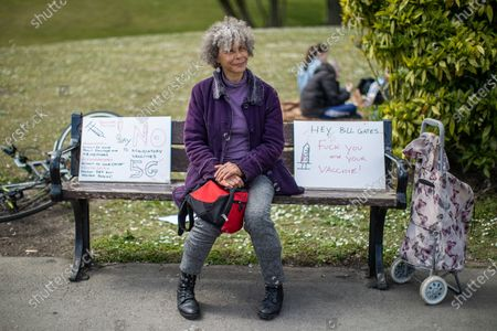 "A women sits on a bench alongside placards reading "" No mandatory vaccines "" , "" Beware Poison "" "" No 5G "" and "" Hey Bill Gates Fuck you and your vaccine "" . An anti-lockdown, ""mass gathering"" demonstration is held in Platt Fields Park in protest at government measures to control the spread of Covid-19. A group calling itself the UK Freedom Movement has organised a series of demonstrations across the UK."