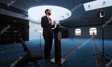 Stock Picture of Imam Omar Suleiman speaks during an online broadcast from the empty Valley Ranch Islamic Center mosque in Irving, Texas, . Many places of worship are seeing more people attending online than showed up in person