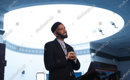 Imam Omar Suleiman speaks during an online broadcast from the empty Valley Ranch Islamic Center mosque in Irving, Texas, . Many places of worship are seeing more people attending online than showed up in person
