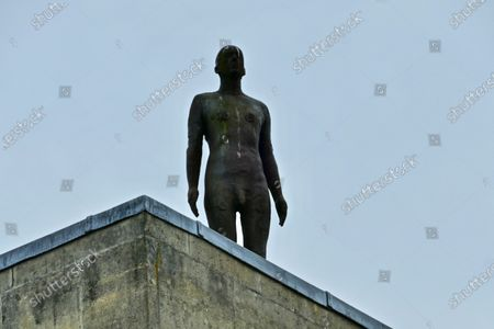 Stock Picture of Anthony Gormley's 'Another Time II' stature overlooks the city