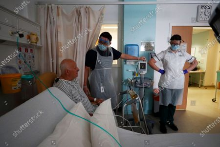 Stock Picture of Occupational Therapists Jason Smith and Grace Rowan assess recovering coronavirus patient Peter Dunn on Ward C22 at The Royal Blackburn Teaching Hospital in East Lancashire, following the outbreak of the coronavirus disease (COVID-19) in Blackburn, Britain, 14 May 2020. Several countries around the world have started to ease COVID-19 lockdown restrictions in an effort to restart their economies and help people in their daily routines after the outbreak of coronavirus pandemic.