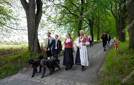Norway's (R-L) Crown Princess Mette-Marit, Princess Ingrid Alexandra, Prince Sverre Magnus and Crown Prince Haakon attend the May 17th celebrations outside their home Skaugum in Asker, Norway, 17 May 2020.  The Constitution Day is celebrated in a new and different way this year because of the coronavirus.
