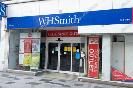 The Post Office in WH Smiths in Slough High Street, Berkshire remains open during the Coronavirus Covid-19 Pandemic lockdown