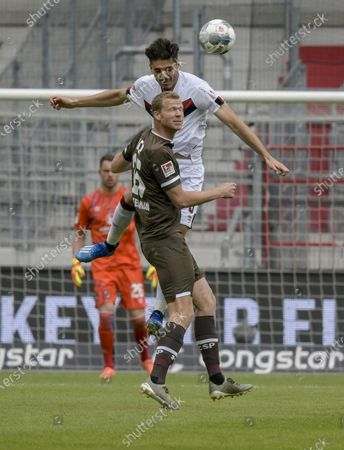 St. Pauli's Henk Veerman and Konstantinos Mavropanos (up) of FC Nuremberg in action during the German Bundesliga second division soccer match between FC St. Pauli and 1. FC Nuremberg in Hamburg, Germany, 17 May 2020. The Bundesliga and Second Bundesliga is the first professional league to resume the season after the nationwide lockdown due to the ongoing Coronavirus (COVID-19) pandemic. All matches until the end of the season will be played behind closed doors.