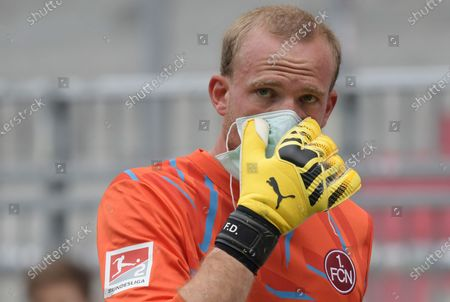 Goalkeeper of FC Nuremberg, Felix Dornebusch, reacts after the German Bundesliga second division soccer match between FC St. Pauli and 1. FC Nuremberg in Hamburg, Germany, 17 May 2020. The Bundesliga and Second Bundesliga is the first professional league to resume the season after the nationwide lockdown due to the ongoing Coronavirus (COVID-19) pandemic. All matches until the end of the season will be played behind closed doors.