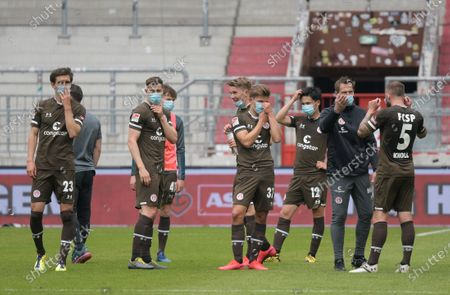 Players of St. Pauli racts after the German Bundesliga second division soccer match between FC St. Pauli and 1. FC Nuremberg in Hamburg, Germany, 17 May 2020. The Bundesliga and Second Bundesliga is the first professional league to resume the season after the nationwide lockdown due to the ongoing Coronavirus (COVID-19) pandemic. All matches until the end of the season will be played behind closed doors.