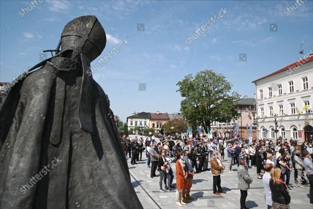 The faithful gather in front of the Minor Basilica of the Presentation of the Blessed Virgin Mary to participate in the mass in Wadowice, Poland, 17 May 2020. St. John Paul II, whose original name is Karol Jozef Wojtyla, the first non-Italian pope in 455 years was born in Wadowice, Poland, 18 May 1920. Poland has planned church services and online events to mark the 100th anniversary of John Paul II, according to media reports.