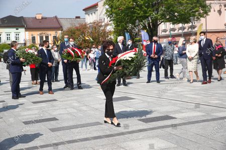 Polish Sejm Speaker Elzbieta Witek (C) lays flowers at a St. John Paul II monument in Wadowice, Poland, 17 May 2020. St. John Paul II, whose original name is Karol Jozef Wojtyla, the first non-Italian pope in 455 years was born in Wadowice, Poland, 18 May 1920. Poland has planned church services and online events to mark the 100th anniversary of John Paul II, according to media reports.
