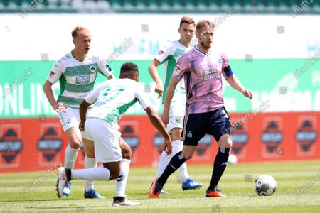Stock Picture of Aaron Hunt (R) of Hamburg is challenged by Julian Green Greuther Fuerth during the German Bundesliga Second Division soccer match between SpVgg Greuther Fuerth and Hamburger SV at Sportpark Ronhof Thomas Sommer in Fuerth, Germany, 17 May 2020. The German Bundesliga and Bundesliga Second Division are the first professional leagues to resume the season after the nationwide lockdown due to the ongoing Coronavirus (COVID-19) pandemic. All matches until the end of the season will be played behind closed doors.