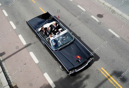 Norway's Crown Princess Mette-Marit (rear-R) and Crown Prince Haakon sit in a convertible car as they attend the May 17th celebrations in Oslo, Norway, 17 May 2020. This year, celebrations of the Scandinavian kingdom's national holiday are starkly different to the habitual revelry due to the ongoing pandemic of the COVID-19 disease caused by the SARS-CoV-2 coronavirus. Patriotic decorations have come to the forefront, with the main gates of Oslo's Royal Palace adorned with hydrangea, birch and ribbons sporting the national colors (red, white and indigo blue). The holiday commemorates the 1814 signing of the Norwegian constitution that declared the realm to be an independent kingdom after centuries of dynastic union with Denmark.